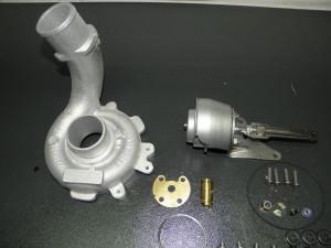 Detalle de caracola de admisión reacondicionada y componentes internos del turbo sustituidos por juego de reparación original.
